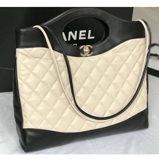 f79cbea24052 Chanel Lambskin 31 Large Shopping Bag Beige and Black A57977 ...